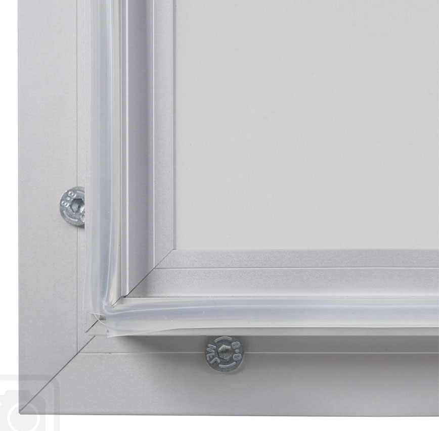 Bulletin Board Lockable. Aluminum display for outdoors. An enclosed magnetic board and whiteboard. Open corner view.